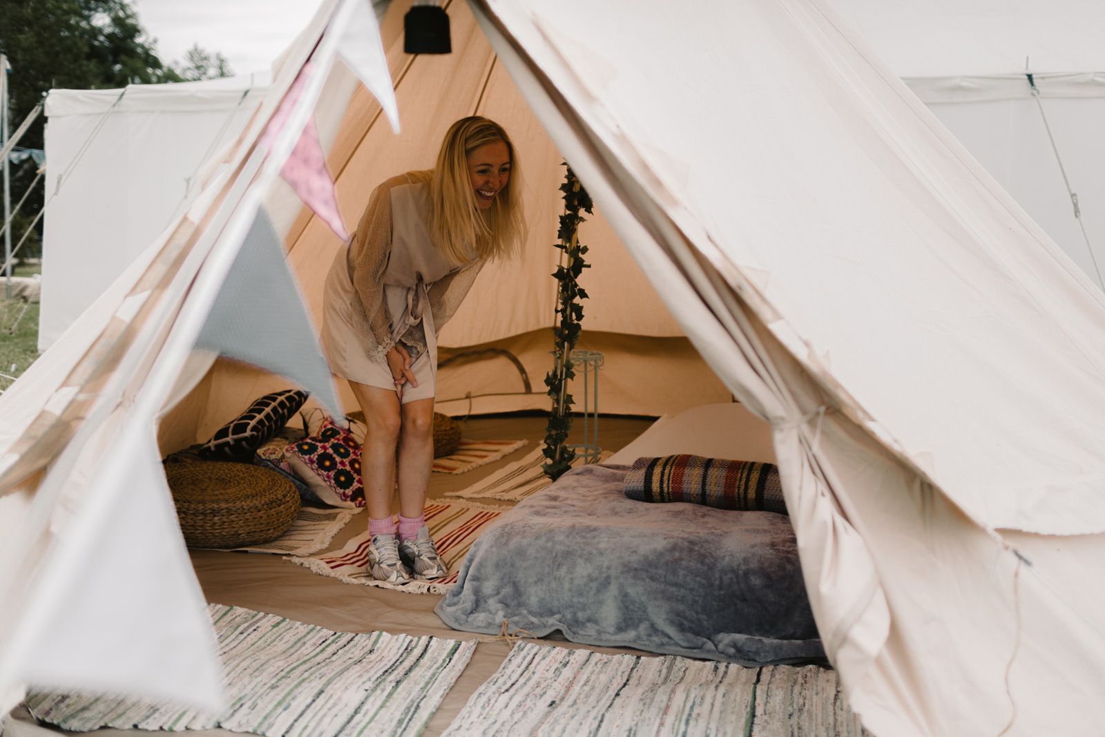 Bride inside tent laughing